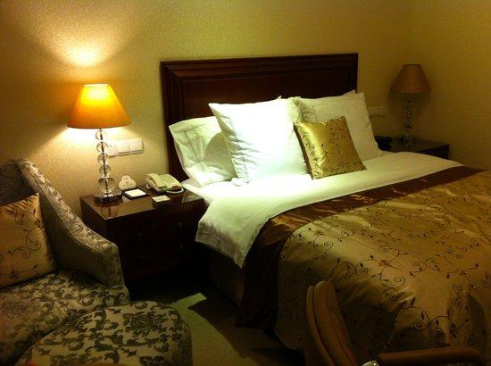 Sunshine Hotel Jiaxing: Bett
