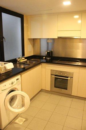 Somerset Grand Hanoi: Kitchenette with washer/dryer