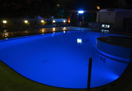 Elarin Studios & Apartments: pool at night