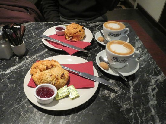 Bewley's Cafe: Fruit scones with butter and jam, and white coffee