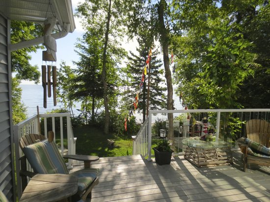 """Post & Pelican B&B: Patio, with wonderful """"whimsys""""  overlooking the lake"""
