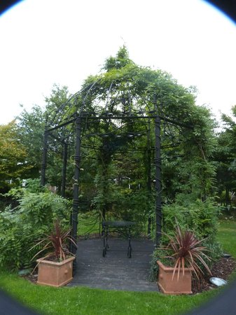 The Courtyard: flowering arch in gardens
