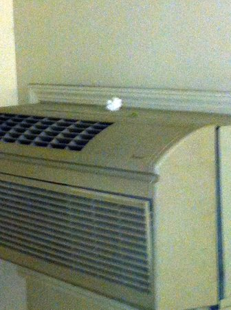 Extended Stay America - Phoenix - Airport - Tempe: Tissue and piece of gum  on top of stairwell A/C unit for a month