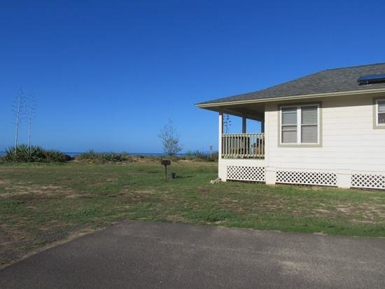 Barking Sands Beach Cottages : View from side of cottge facing your daily view of the ocean.