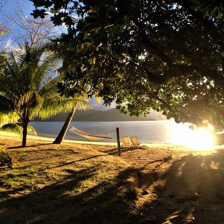 Matangi Private Island Resort: Every bure has chairs and a hammock in front.