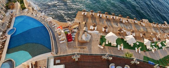 Charisma De Luxe Hotel : Pool and sundeck by the Aegean Sea