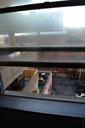 The McLure Hotel & Suites: This was our view, looking through a filthy window at more filth in the parking ramp