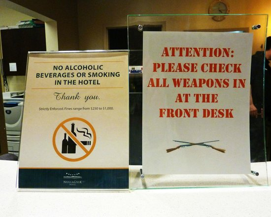 Nullagvik Hotel: Signs at the front desk. No booze, no guns.