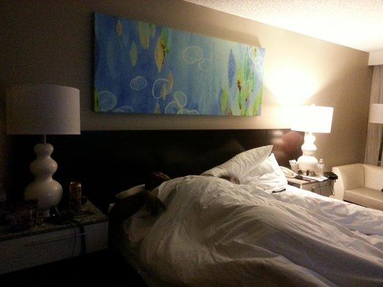 Radisson Resort Orlando-Celebration: husband hiding in comfy bed