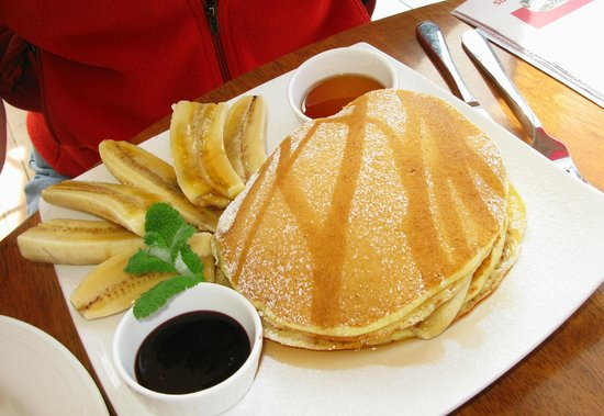 First In Cafe: Pancakes with banana and maple syrup.