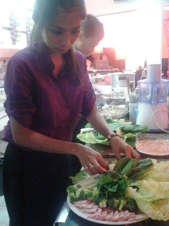 "Swiss Italian Restaurant Cebu: Agnes preparing a ""Fondue Chinoise"""