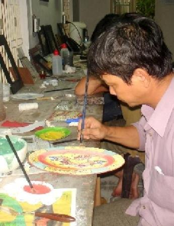 Artist working on the painting