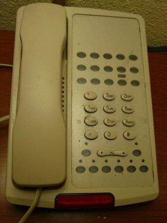 Surf Motel: Propreté du téléphone qui reflète l'ensemble de la chambre