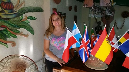 Casa Hostal Ivan & Lucy: My lovely wife with all the flags as a sing of all the nationalities are welcome. ..