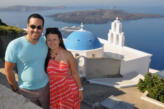 Private Santorini Tours - Private Day Tours: Us with a postcard background