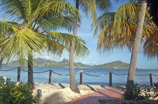 Palm Island Resort & Spa: View from the cottage over to Union Island