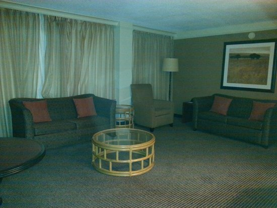 Holiday Inn Baltimore-Inner Harbor : Front Room with two pull out sofas, a big screen TV, and a powder room.