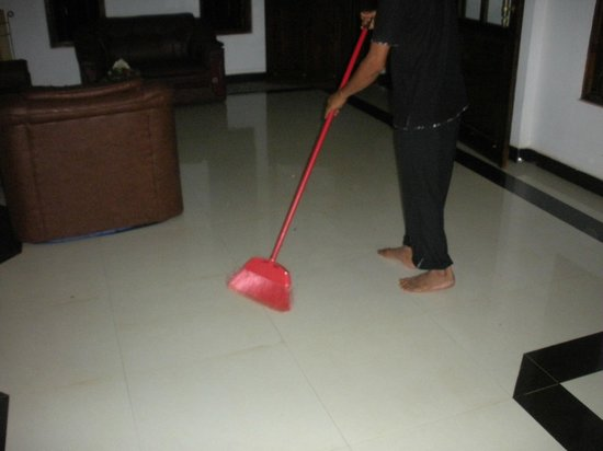 Grand Kalundawa Waterfront Resort : Staff guy removing insect from the lobby floor. AVOID