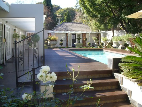 Touch of Class Guest House: The pool terrace and garden flat