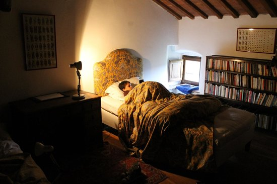 "Castello di Potentino: My son relaxing with his book. There was a ""Narnia Wardrobe"" in the kids bedroom."