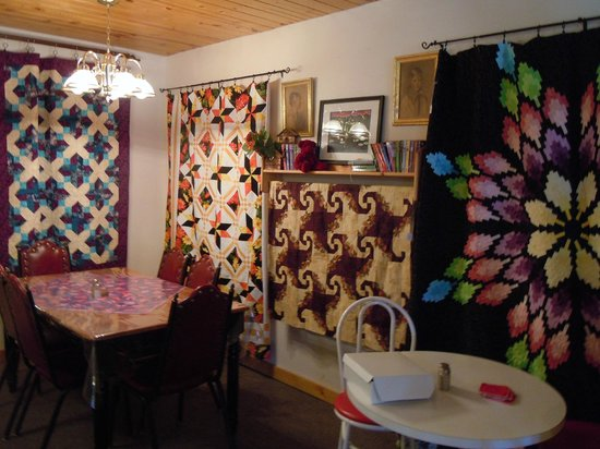 Louise's Place: Interior of Louisa's Coffee House with quilts for sale