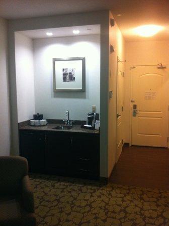 Hilton Garden Inn Edmonton International Airport: sink and refrigerator and entranceway