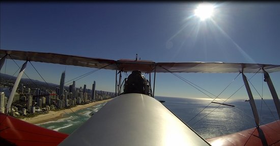 Tiger Moth Joy Rides: Flying along the beachfront