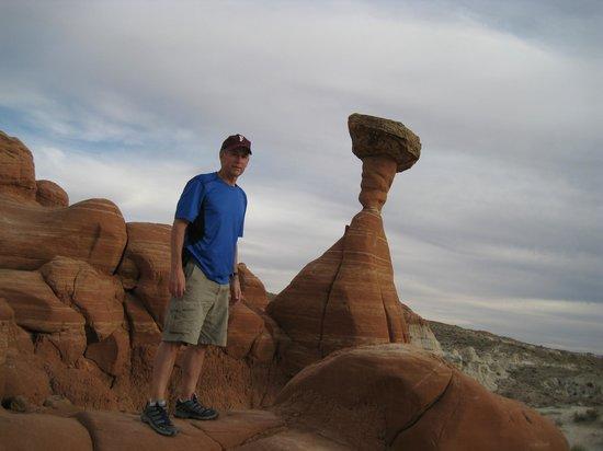 Paria Rimrocks Toadstool Hoodoos: Standing next to a prominent hoodoo.