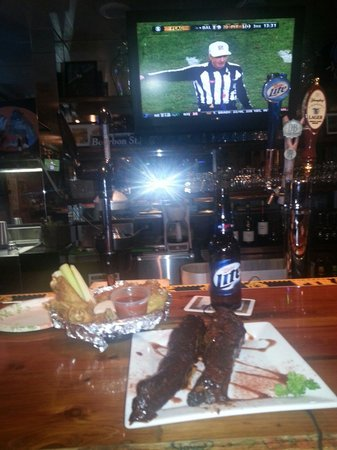 Pickled Herring Pub: Dollar Ribs and half price wings for football