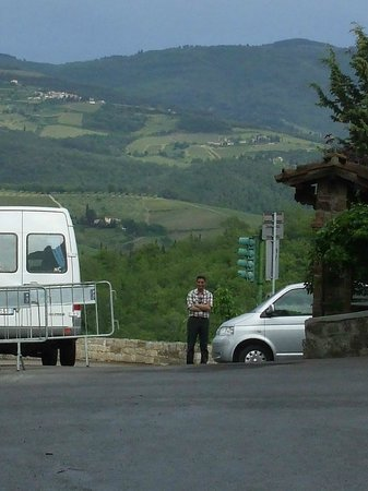 Tuscany Car Tours: Wonderful, patient, knowledgable, charming Paolo waiting for us by the car in Montefioralle.
