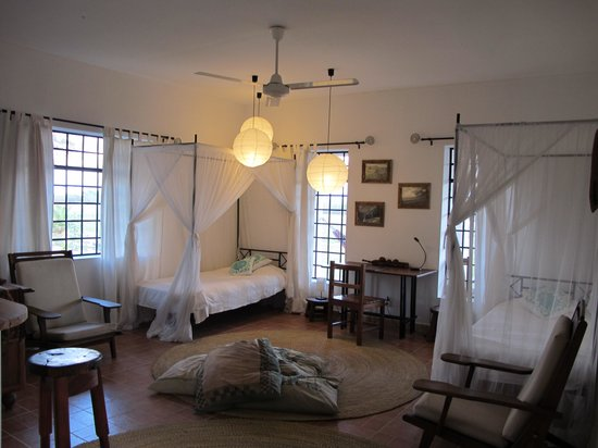 Mbuyuni Farm Retreat: living room with 2 beds