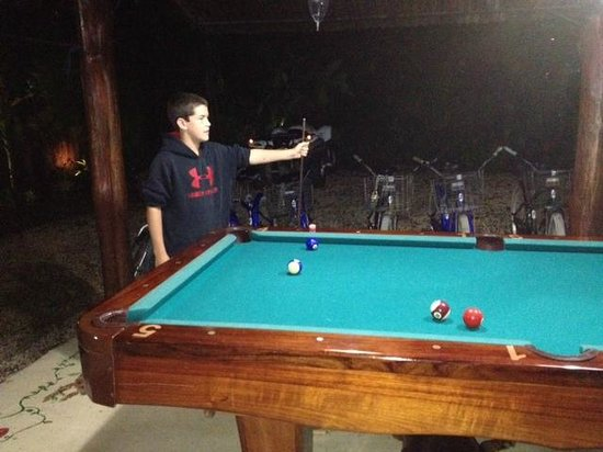 Funky Monkey Lodge : My son brushing up on his pool skills.
