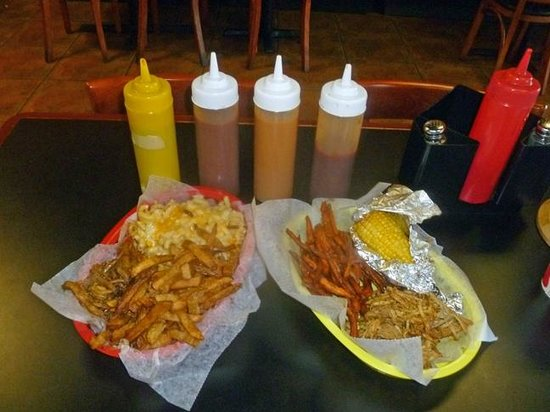 Fuego Lento BBQ: pulled pork on left, turkey on right; Sauces: spicy, smoky, mustard, sweet