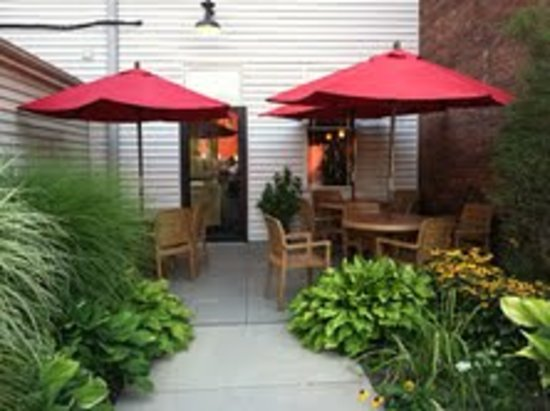Boston Bean Cafe : Outdoor seating in the rear with municiple parking available.