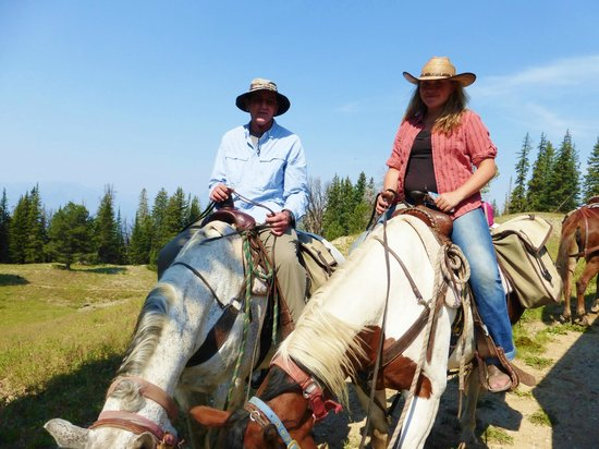 Skyline Guest Ranch and Guide Service: John, guest, with Jackson family guide, Kameesha