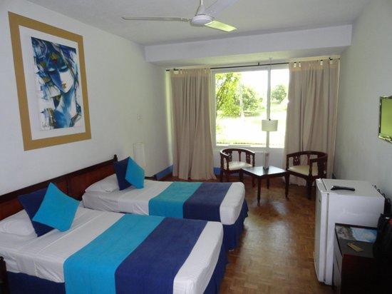 Palm Village Hotel: la chambre