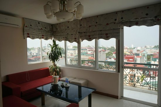 Icon 36 Hotel: sitting room with view over Hanoi