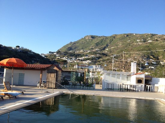 Residence Baia di Sorgeto: The wonderful outdoor pool - looking north towards the centre of the island and Mt Epomeo