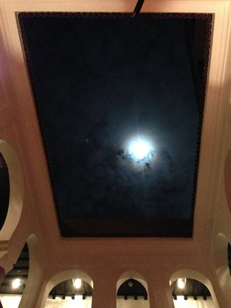 Riad Carllian : Looking up to the roof patio at night