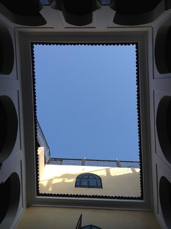Riad Carllian: Looking up to the roof patio during the day