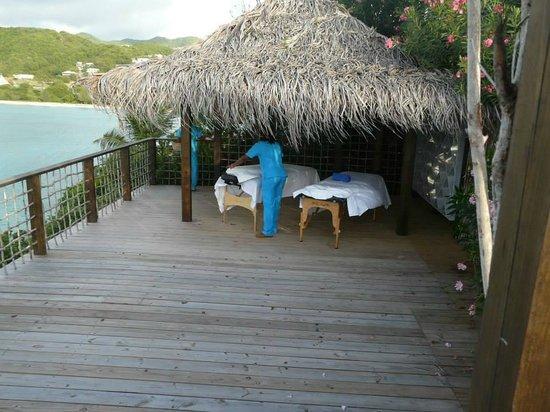 Cocobay Resort: Massage tables on the deck overlooking the ocean