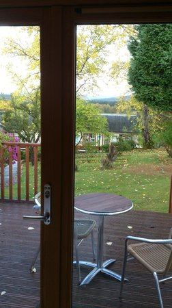 The Boat Hotel: View ffrom Garden Room 2. Decking, garden and train station