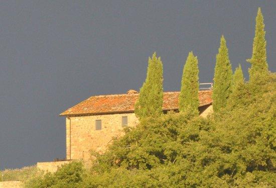 Fattoria Poggerino: The setting sun on a building across the hills.