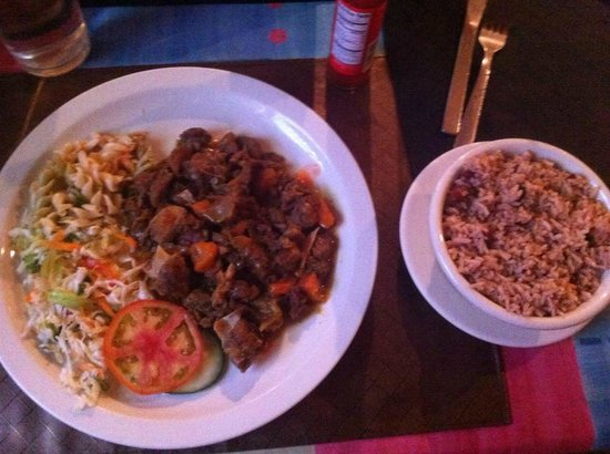 Sweet Spice Restaurant: Curried Goat, Slaw, and Rice