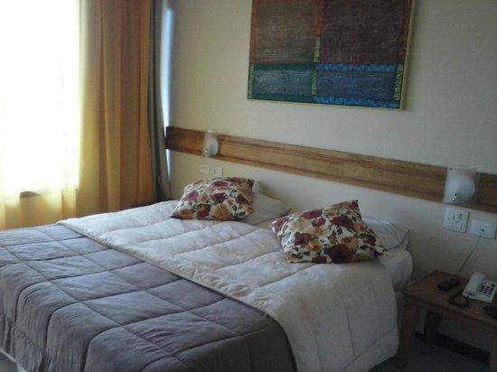 Pousada Amancay : cama confortável e quarto aconchegante!!!