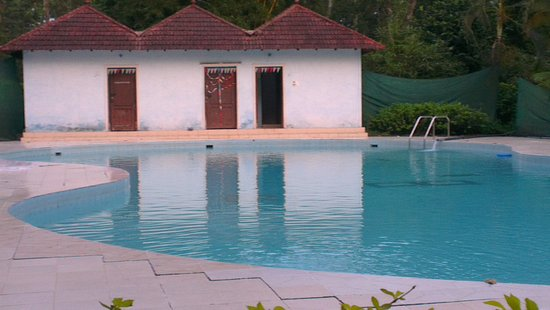 Entrance gate picture of coorg county resort suntikoppa tripadvisor Hotels in coorg with swimming pool