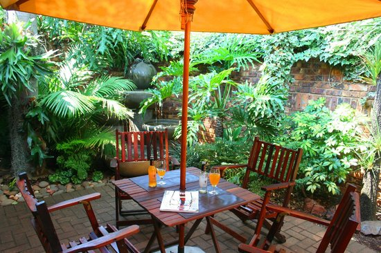 Africa House Accommodation: A private garden in one of our self-catering units.
