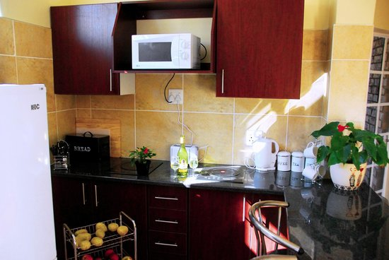 Africa House Accommodation: One of the kitchen in our self-catering units.