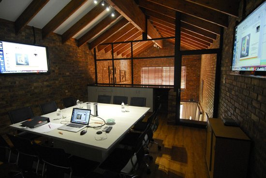 Africa House Accommodation: This is our conference room, ideal for meetings for up to  people.
