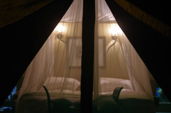 White Elephant Safari Lodge: Our bed - turned down and a sweet something on the pillow each night.
